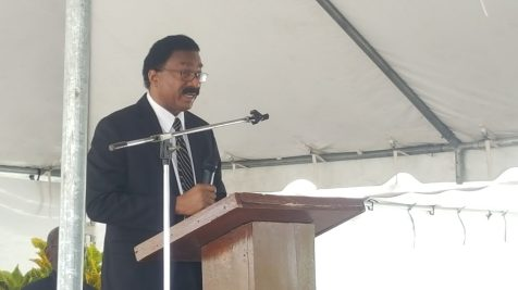 Minister Basil Williams addressing the mourners