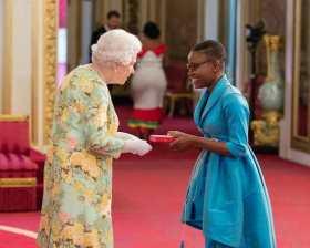 Queen's Young Leader, Marva Langevine receiving her award from HM Queen Elizabeth II.