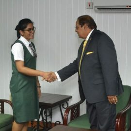 Prime Minister, Moses Nagamootoo welcomes DPI's Director for the day, Devika Rajaram.
