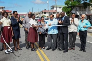 Prime Minister Moses Nagamootoo and his wife, Mrs. Sita Nagamootoo among other ministers, CDB representative, students and project contractor observe the ribbon-cutting ceremony.