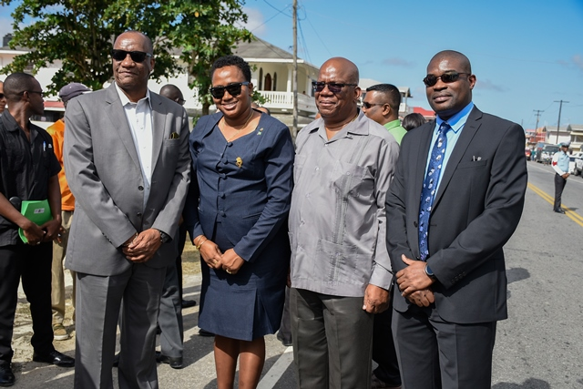 Minister Joseph Harmon, Minister Annette Ferguson, Minister Winston Jordan and Minister David Patterson take a moment to have their photograph taken after the ribbon-cutting ceremony.