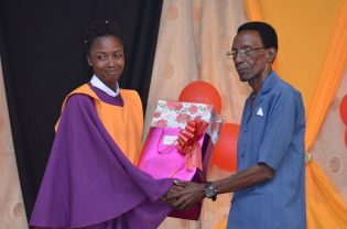 Best Graduating trainee receiving her Award from Center Administrator, Syne Scott