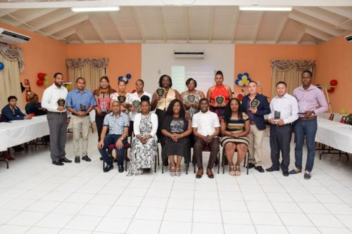 Seated are senior officials of the Public Health Ministry including Minister within the ministry Dr, Karen Cummings, Director of Regional and Clinical Services Dr. Kay Shako among others pose with some of the awardees along with representatives of other awardees.