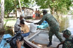 CDC rep presents a package to a Kwakwani resident