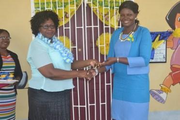 Regional Chairman, Genevieve Allen officially handing over keys to Headmistress Nicola Jeffers.