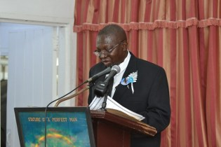 Clerk of the National Assembly, Sherlock Issacs delivering his tribute.