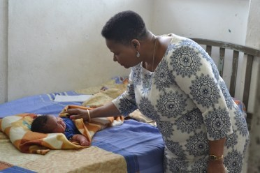 Minister Lawrence visiting other babies in the ward.