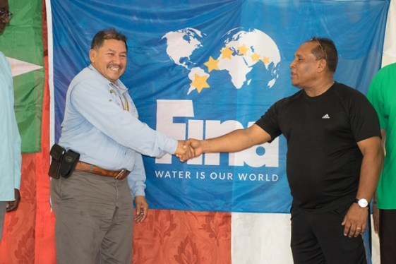 Minister of Indigenous Peoples' Affairs, Sydney Allicock and President of the Guyana Amateur Swimming Association, Ivan Persaud at the launch of the Guyana Amateur Swimming Association outreach in Mainstay/Whyaka.