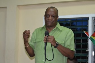 Minister of State, Joseph Harmon addressing the gathering at The Grove Multipurpose Centre, Region Three