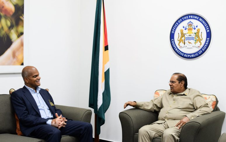 Prime Minister, Moses Nagamootoo and High Commissioner to India, Dr. David Goldwin Pollard interact with each other
