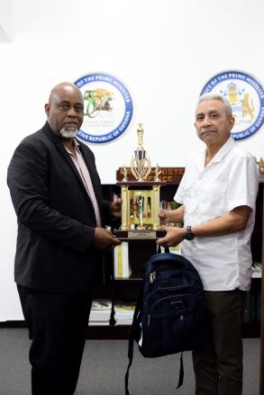 Special Assistant Public and Diaspora Affairs and Investigations, Wallace Ng-See-Quan makes the donation to Member of Parliament, Audwin Rutherford