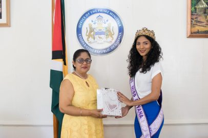 Mrs. Sita Nagamootoo presents Miss World Guyana 2018, Ambika Ramraj with a token of appreciation