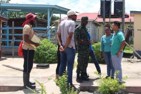 Lt. Col. Kester Craig and team in discussion with Kwakwani health officer