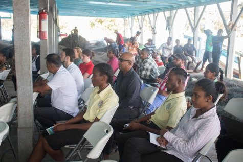 Fishermen listening to the consultation at the No. 66 Fish Port Complex, Corentyne Berbice