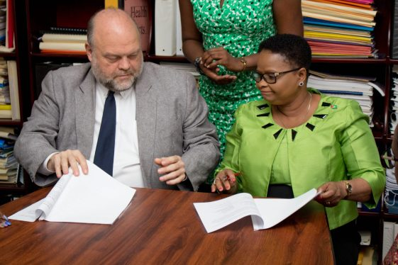Minister of Public Health, Volda Lawrence, Country Director of Peace Corps Guyana, Kury Cobham and US Ambassador Perry Holloway exchange Memorandum of Understanding which were signed.