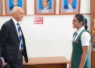 DPI's Director for the day, Devika Rajaram interacts with Minister of Communities, Ronald Bulkan.