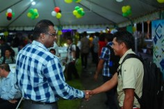 Minister of Public Security, Khemraj Ramjattan greets a Toshao.