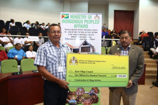 Toshao of Kato village Region Eight Clifton Perreira, receiving the presidential Grant from Minister of Indigenous Peoples Affairs, Sydney Allicock.