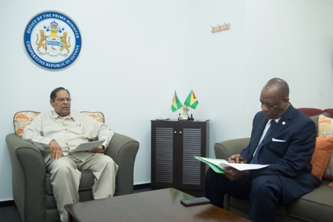Minister of State, Joseph Harmon briefing Prime Minister Moses Nagamootoo on the Region Nine areas affected by flooding.