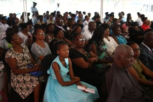 Members of the Guyana Police Force and relatives gathered to honored 'fallen heroes