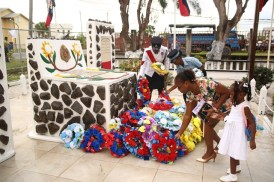 Members of the Guyana Police Force and relatives lay wreaths in remembrance of the fallen officers