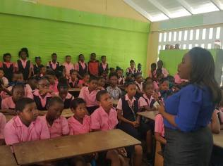 Mayor of Linden Waneka Arindell interacting with students of the One Mile Primary School