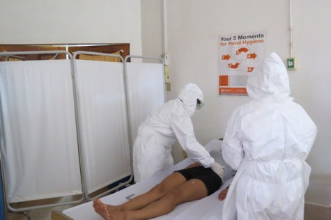 Medical examination on patient in isolation room during the simulation exercise.