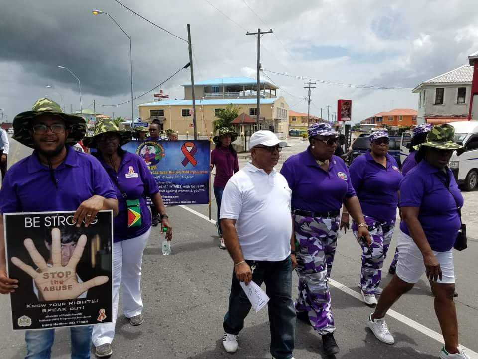 Region Three, REO Denis Jaikaran (in white cap), members of the United Bridge Builders Mission and other participants during the march and rally against domestic violence and suicide