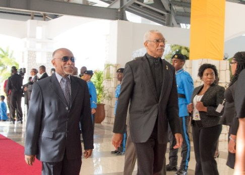 President David Granger and Minister of Foreign Affairs, Carl Greenidge arrive for the opening of the 39th Meeting of the Conference of Heads of Government of CARICOM, in Montego Bay, Jamaica.
