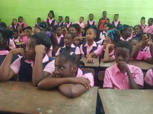 Students of the One Mile Primary School paying rapt attention to the LG discussions