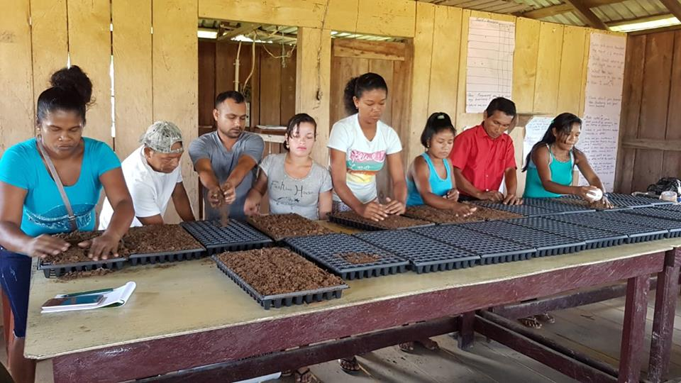 Some of the residents who received support from the National Agricultural Research and Extension Institute (NAREI)