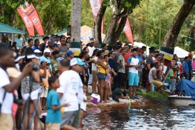 Patrons enjoying the boat racing competitions