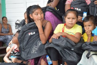 Student of Bartica displaying their back-to-school supplies.