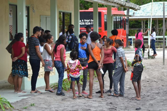 Youths in their various groups engaged in activity as the camp begins