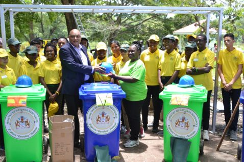 Minister of Natural Resources handing over equipment to beautify the Esplanade to Mayor of New Amsterdam Winifred Haywood