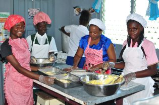 Students involved in a cake making session