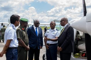 Minister Harmon in conversation with Commanding Officer of the Air Corps Lt. Col. Courtney Byrne, Director-General of the Guyana Civil Aviation Authority (GCAA), Egbert Field, Chief of Staff Brig. West and Officer in Command at the Flight Operations Department, Major Mohinder Ramjag