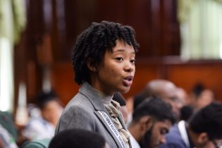 Opposition's Youth Shadow Minister of Natural resources, Miracle Miller during her presentation