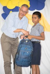 Minister of Business, Dominic Gaskin presents a backpack to one of the NGSA graduates