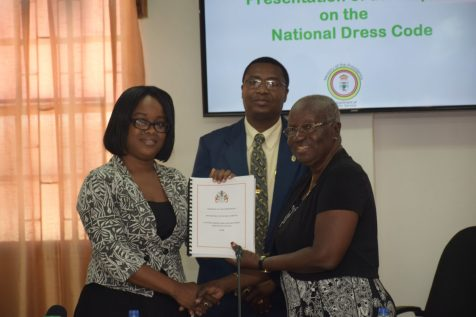 Cheryl Sampson receives the report from Committee chair Akilah Doris on behalf of Minister of Public Service, Dr. Rupert Roopnaraine