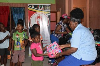 Minister within the Ministry of Communities with responsibility for Housing, Valerie Adams-Patterson-Yearwood handing out school supplies to students of Kwakwani
