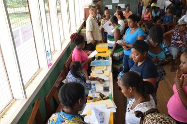 Residents getting their house lot allocated by the staff of Central Housing and Planning Authority (CH&PA)