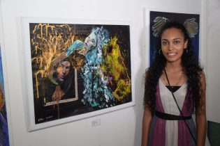Esther Nankoo displaying her painting