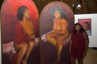 Joanna Suchit displaying her painting
