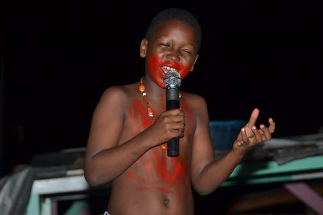 """A primary school performing the poem """"Ol Higue"""" pupil"""