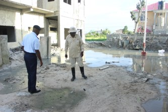 Director General (ag) of the Civil Defence Commission (CDC), Lt. Col. Kester Craig and Guyana Geology and Mines Commission (GGMC) official assessing the situation at the eruption site