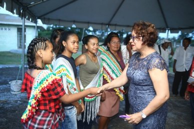 Minister within the Ministry of Indigenous Peoples' Affairs Valerie Garrido-Lowe greeting one of the groups who are in Georgetown to participate in the Heritage launch.