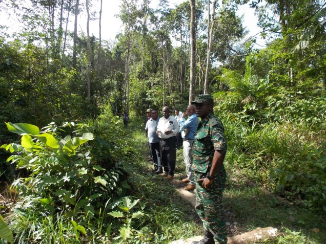Minister of Citizenship, Winston Felix along with a team assessing prospective land for the humanitarian centre