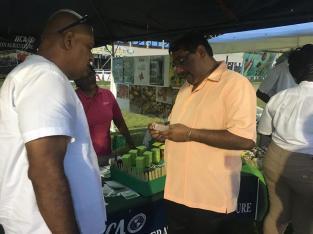 Regional Chairman David Armogan and Prime Minister Regional Representative Gobin Harbhajan look at locally produced soaps