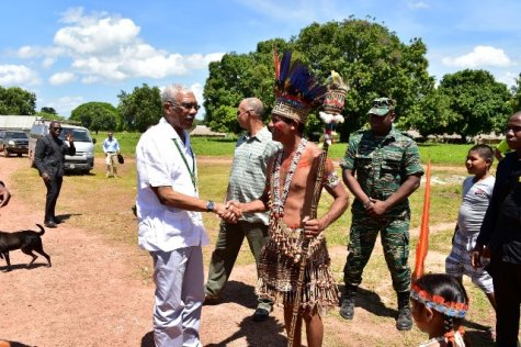 President David Granger greets Toshao of Shulinab Village, Mr. Nicholas Fredericks upon arrival at Heritage Day celebrations held at Shulinab Village, Upper Takutu- Upper Essequibo Region.